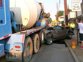 Police Capt. David Dalcamo said the concrete truck hit the pickup from behind, pushing it into a car and a utility pole.