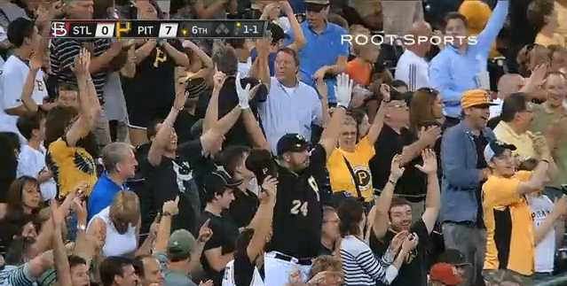 Demitrius Thorn (center) celebrates one of Pedro Alvarez's two home runs against the St. Louis Cardinals at PNC Park