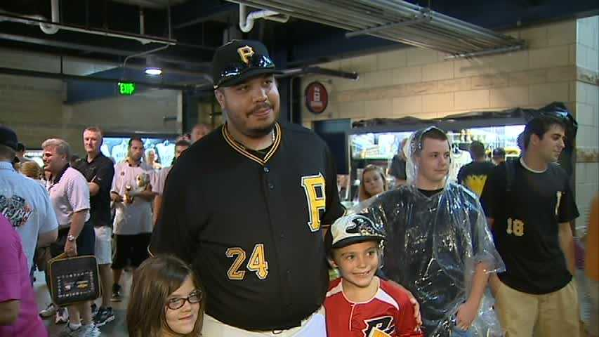 Demitrius Thorn takes a picture with two young Pirates fans at PNC Park