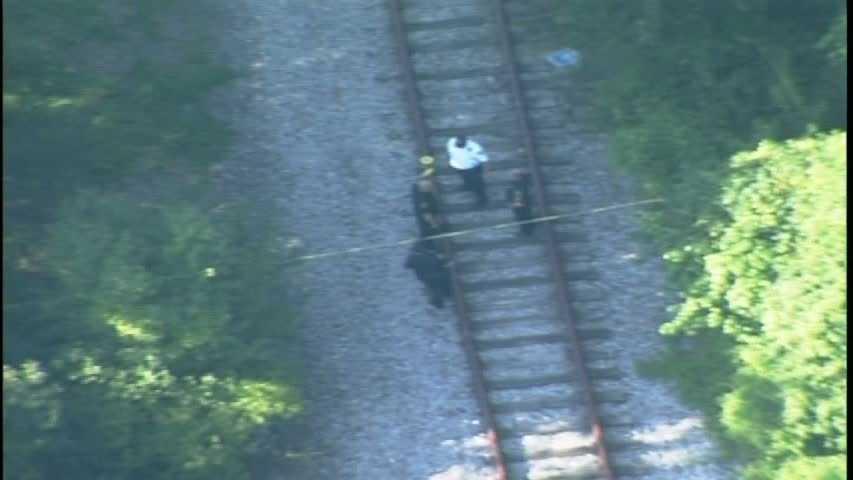 police investigate on railroad tracks