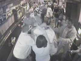Another person got involved, followed by a physical confrontation and other customers stepping in to separate them.