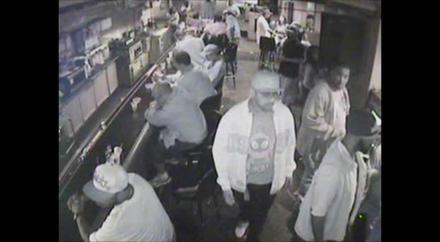 Surveillance video shows a man walking toward the front door.