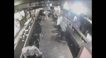 Customers in the bar begin to move out of the way.