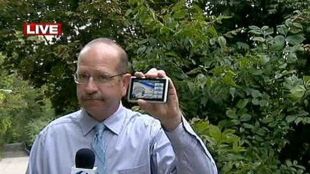 Jim Parsons holding GPS