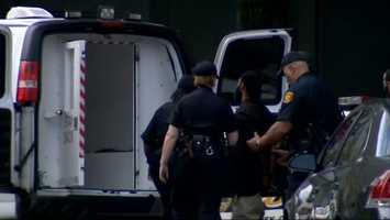 Klein Michael Thaxton is taken into police custody outside Gateway Center in downtown Pittsburgh