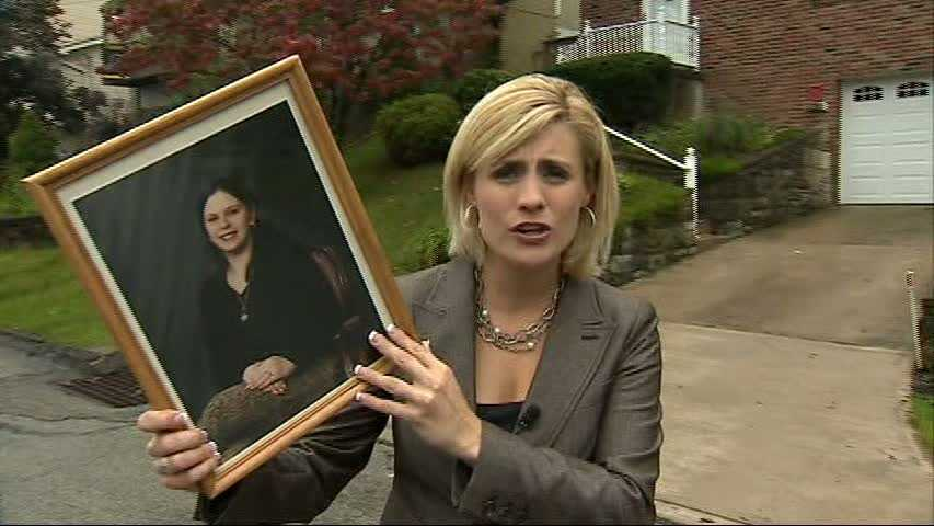 Janelle Hall holds Angela McGowan's picture.