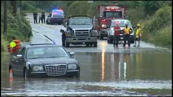In Baldwin, a man had to be rescued from his vehicle when he tried driving through flood waters on Streets Run Road, near Chapon's Greenhouse.