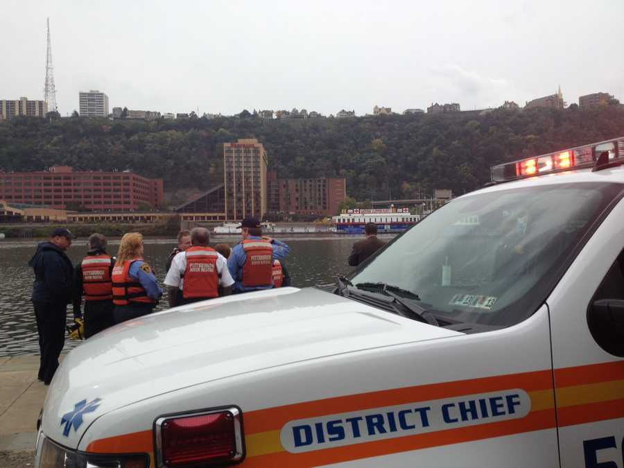 Pittsburgh emergency responders are crowded around the Mon Wharf for reports of a body in the Monongahela River.