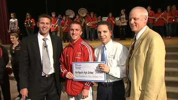 Cody Walter accepts a check for $250 from Clearview Federal Credit Union on behalf of Northgate High School