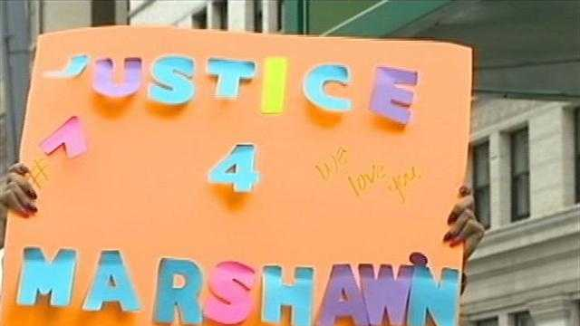 "A group of protesters took to downtown Pittsburgh on Monday, demanding ""Justice for Marshawn"" after a judge allowed a teenager awaiting her homicide trial to serve house arrest."
