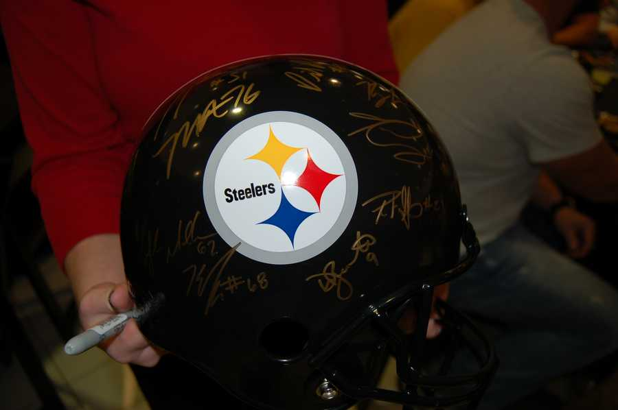 Each Steeler who came out Tuesday night, autographed the helmet