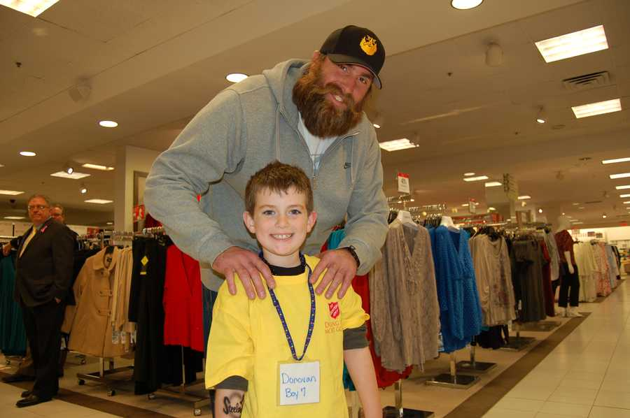 PITTSBURGH, PA - Brett Keisel and his little shopping buddy