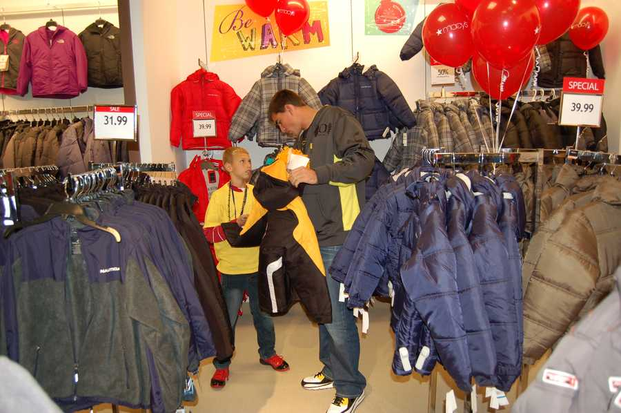 PITTSBURGH, PA - David Paulson helps his little shopping buddy find the perfect jacket