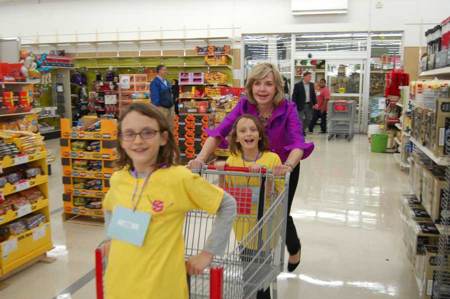 Anchor Sally Wiggin with her two little shopping buddies take off for their turn at the store.