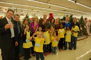 A group from Thursday night's shopping trip hold up four fingers for Channel 4.