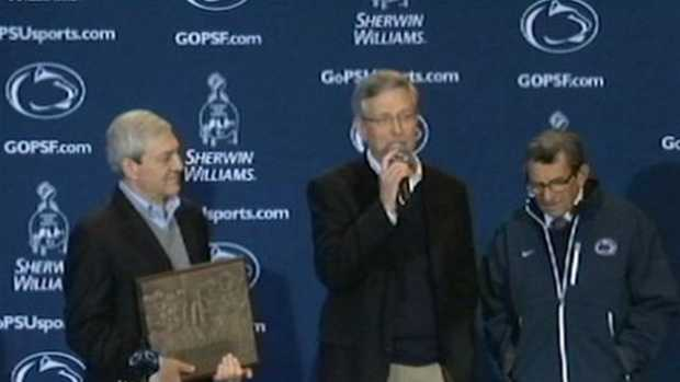 Spanier (pictured, left, with Curley and Paterno) was released after surrendering for arraignment. He is awaiting trial.