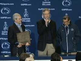 Spanier (pictured,left, with Curley and Paterno) was released after surrendering for arraignment. He is awaiting trial.
