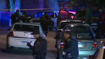 About 25 shots were fired from a high-powered rifle, Pittsburgh police said.