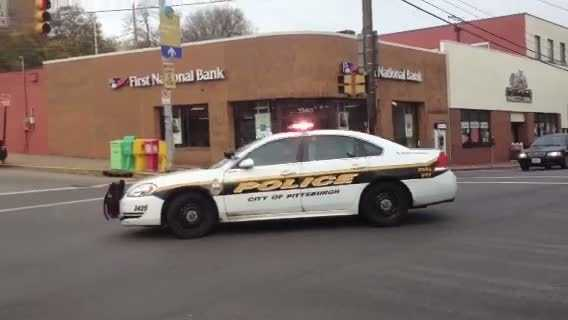 A suspected bank robber was arrested Wednesday after being chased through the Squirrel Hill business district by Pittsburgh police cars.