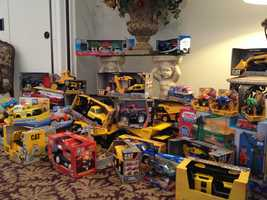 More than 200 toy trucks were waiting as mourners began to arrive for the boy's funeral.