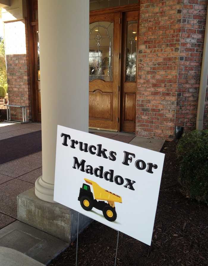 In lieu of flowers, the family asked for toy trucks to be donated to a children's Christmas charity.