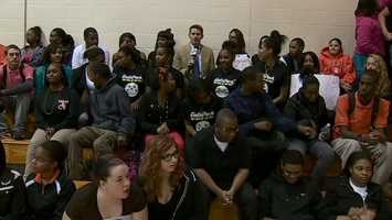 Action Sports' John Meyer joins Clairton students in the bleachers