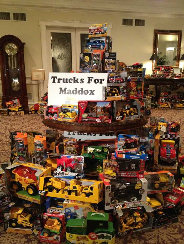 The estimated number of donated toy trucks now exceeds 1,000.