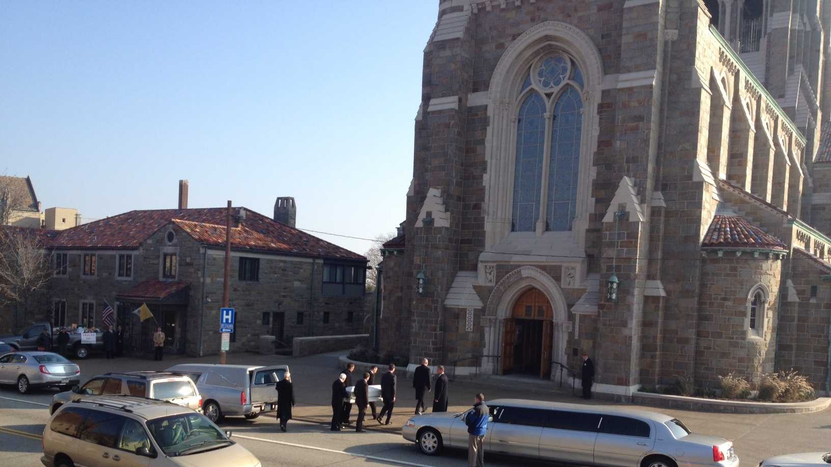 Pallbearers carried the small casket into the church.
