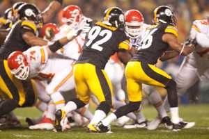 Heavy rain and high winds couldn't keep the Steelers and Chiefs from playing... In this photo you can see the rain beating down on the play.