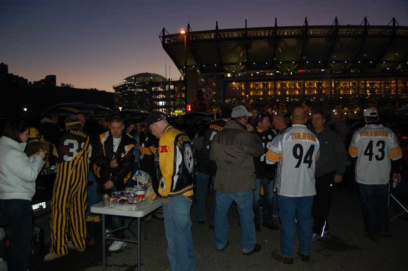 Tailgaters take things up a notch as the sun goes down behind Heinz Field.