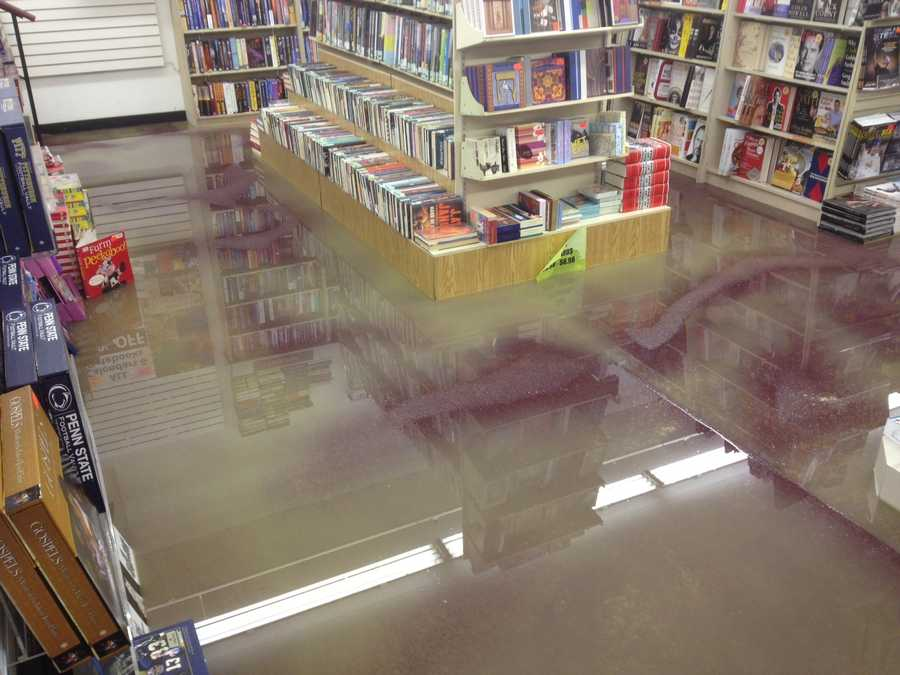 A water main broke under the sidewalk at the Marshalls Plaza on Greentree Road and flooded Bradley's Book Outlet.
