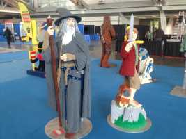 """Gandalf and Sam from """"The Lord of the Rings"""" (with Chewbacca and R2-D2 from """"Star Wars"""" in the background)."""