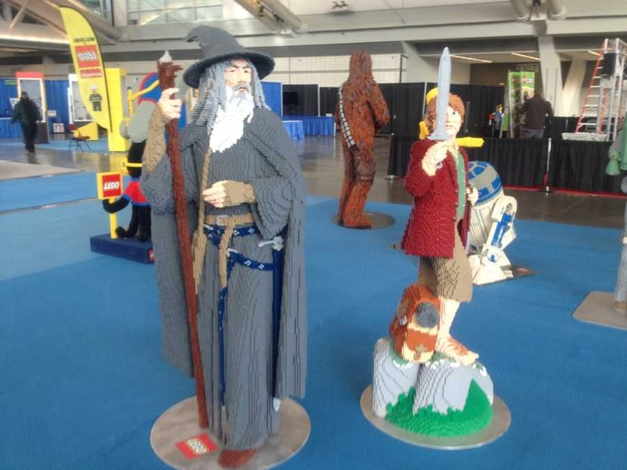 "Gandalf and Sam from ""The Lord of the Rings"" (with Chewbacca and R2-D2 from ""Star Wars"" in the background)."