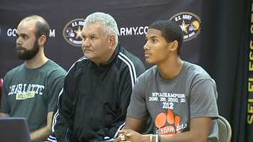 Clairton head coach Tom Nola (center) and Tyler Boyd