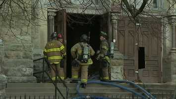 Firefighters had to break down the church's oak doors to get inside.