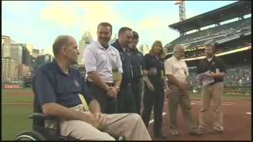 Cranberry Police Cpl. Dan Hahn was recognized on the field at PNC Park before a Pirates game.