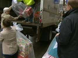 Employees helped load the gifts into trucks to be driven to a Salvation Army warehouse.