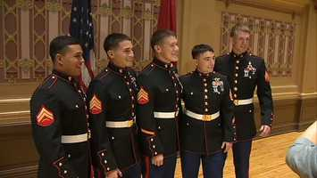 Gerardi with his fellow Marines after the ceremony at Soldiers & Sailors Memorial Hall.