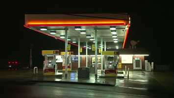 State police said a man with a sword approached a woman while she was pumping gas and robbed her in Redstone Township, Fayette County.