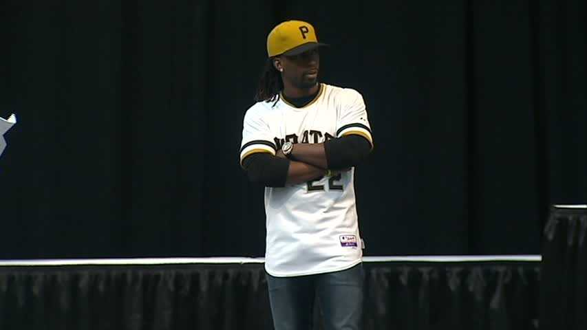 All-Star outfielder Andrew McCutchen modeled the new duds -- a mustard gold cap and pullover-style jersey -- on Friday as the team gets ready for its annual PirateFest at the David L. Lawrence Convention Center.