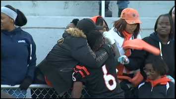 Titus Howard gets a hug after the game