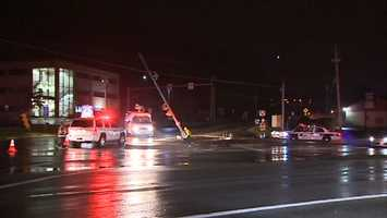 Two people were hurt in a crash that damaged a telephone pole and left it resting on some wires on Route 19 in Marshall Township.