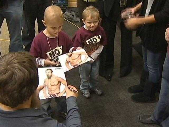 And some pictures that the tag team champion personally autographed for Connor.
