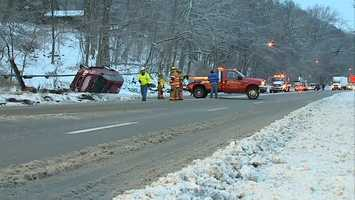Part of Route 65 southbound was shut down Thursday morning when an SUV flipped over on the side of the road.