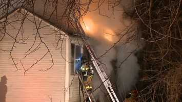 Neighbors in Pittsburgh's Carrick area say a man was at work when his home caught fire early Tuesday morning.