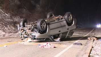 A car hits a pole, rolls over and comes to rest on the lower part of the driver in Penn Hills.