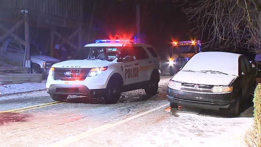 A car slid off a snowy road, down a hill and hit a house and a gas line early Wednesday morning in Penn Hills.