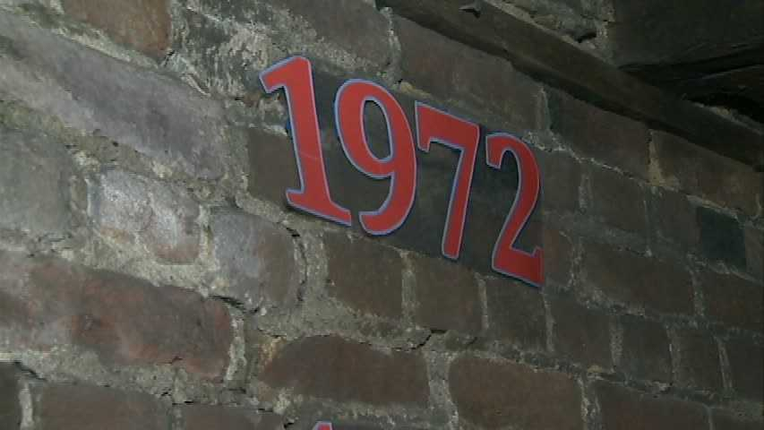 Markers on the wall show the years that floods have happened, and to what level the waters rose. The highest was in 1972 ...
