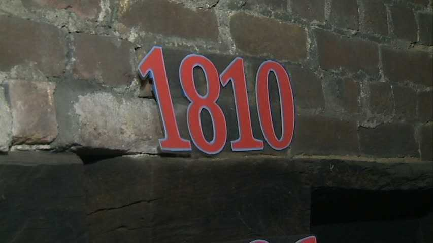 ... followed by 1810, just above gun-hole level ...