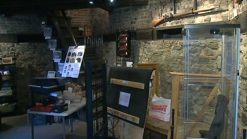 Antique guns and various other artifacts are on display around the blockhouse.